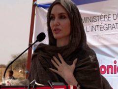 Angelie Jolie speaks at the Malian refugee camp in Goudebo, Burkina Faso (AP Photo)