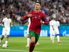 Cristiano Ronaldo sent Portugal through to the round of 16 with a brace in their Euro 2020 Group F match with France (Darko Bandic/AP/PA)
