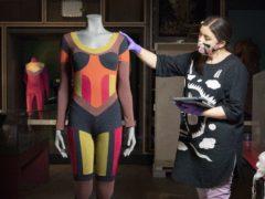 Lead textile conservator Elizabeth Anne Haldane carries out a condition check on a bodysuit by designer Pam Hogg (Jane Barlow/PA)