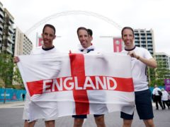 Fans arrive at Wembley ahead of the crunch England-Germany match (Zac Goodwin/PA)