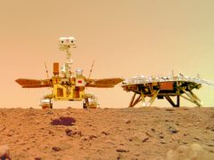 The Chinese Mars rover Zhurong is seen near its landing platform taken by a remote camera that was dropped into position by the rover (CNSA/AP)