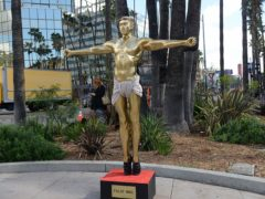 A life-size fiberglass sculpture of Kanye West reimagined as an Oscar statue is among the contemporary artworks going on sale for the first time (Julien's Beverly Hills/PA)