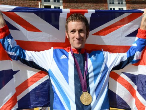 Great Britain's Bradley Wiggins with his gold medal after winning the time-trial at the 2012 Games in London (Owen Humphreys/PA)