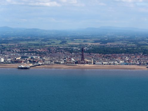 An aerial view of Blackpool Tower and beach (Peter Byrne/PA)