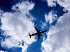A silhouette of a plane as it passes overhead in Isleworth, West London