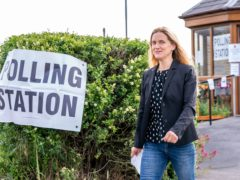 Labour party candidate Kim Leadbeater leaves Norristhorpe United Reformed Church polling station after casting her vote (Danny Lawson/PA)