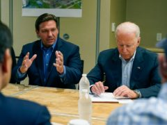 President Joe Biden listens as Florida Gov. Ron DeSantis speaks during a briefing in Miami Beach, Fla., Thursday, July 1, 2021, about the collapsed condo tower in Surfside. (AP Photo/Susan Walsh)