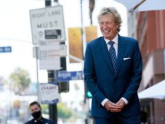 TV producer Nigel Lythgoe has criticised the Duke and Duchess of Sussex over how they handled their departure from royal duties (AP Photo/Chris Pizzello)
