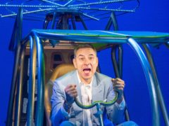David Walliams tried out a model helicopter while visiting the West End adaptation of his children's book Billionaire Boy (Dominic Lipinski/PA)