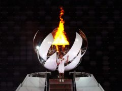 Japan's Naomi Osaka lights the Olympic flame during the opening ceremony of the Tokyo 2020 Olympic Games (Mike Egerton/PA Images).