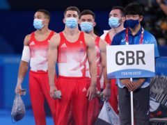 Max Whitlock, second left, gets his gymnastics campaign under way in Tokyo (Mike Egerton/PA)