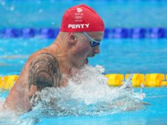 Adam Peaty is through to the semi-finals of the 100m breaststroke (Adam Davy/PA)