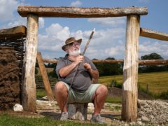 Veteran Kevin Reilly helps with work on a bronze age roundhouse (Andrew Matthews/PA)