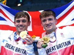Tom Daley, left, and Matty Lee celebrate winning gold (Adam Davy/PA)