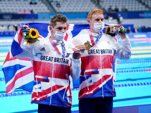 Tom Dean, right, and Duncan Scott, left, with their medals (Adam Davy/PA)