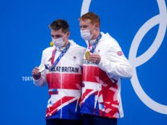 Tom Dean, right, with his gold medal and Duncan Scott with his silver (Adam Davy/PA)