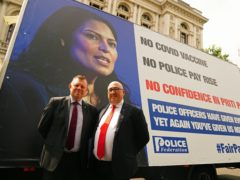 Chairman of the Police Federation John Apter (left) and Ken Marsh, Chairman of the Metropolitan Police Federation stand in front of an advertising van with a poster of Home Secretary Priti Patel as they deliver a letter to 10 Downing Street, London, setting out officers' anger over a pay freeze and objections to the Government's Beating Crime Plan (Victoria Jones/PA)
