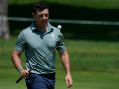 Rory McIlroy is in medal contention in Tokyo (Matt York/AP)