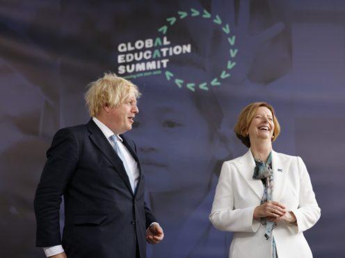 Prime Minister Boris Johnson alongside former PM of Australia Julia Gillard at the Global Education Summit (Tolga Akmen/PA)