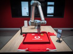 5G-powered robotic arm allowed Maro Itoje, Chris Harris and Ken Owens in South Africa to sign jerseys located in London (Vodafone/PA)