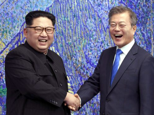 North Korean leader Kim Jong Un and South Korean President Moon Jae-in have agreed to restore suspended communication channels and improve ties (Korea Summit Press Pool/AP)