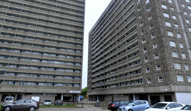 Resident checked over by ambulance after fire in lobby of Aberdeen high-rise