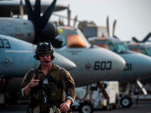 The flight deck of aircraft carrier USS Ronald Reagan to board an MH-60S SeaHawk helicopter to head to an oil tanker that was attacked off the coast of Oman in the Arabian Sea on Friday, July 30, 2021. An attack on an oil tanker linked to an Israeli billionaire killed two crew members off Oman in the Arabian Sea, authorities said Friday, marking the first fatalities after years of assaults targeting shipping in the region. (Mass Communication Specialist 2nd Class Quinton A. Lee/U.S. Navy, via AP)