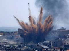 Human Rights Watch has accused the Israeli military of carrying out attacks that 'apparently amount to war crimes' during an 11-day war against Hamas in May (Hatem Moussa/AP)