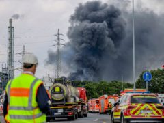 The explosion sent a large black cloud of smoke into the air (Oliver Berg/dpa via AP)