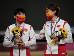 Bao Shanju, left, and Zhong Tianshi , of China, celebrate their gold medals during a ceremony for the track cycling women's team sprint finals at the 2020 Summer Olympics (Christophe Ena/AP)
