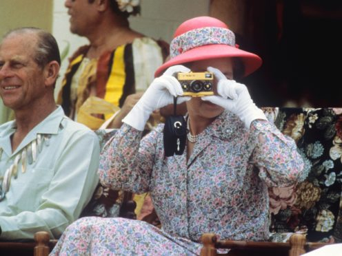 The Queen taking photographs during her visit to the South Sea islands of Tuvalu in 1982 (Ron Bell/PA)