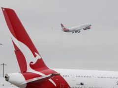 Qantas plans to resume flights between Australian and the UK – and other high-vaccination countries – in December (Steve Parsons/PA)