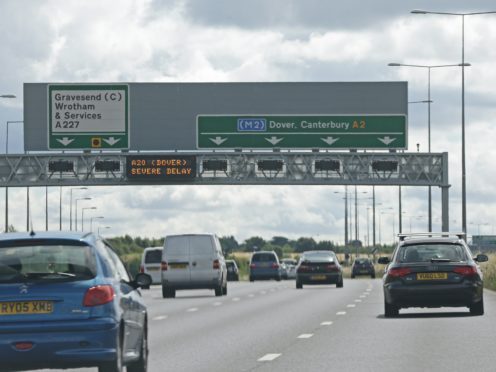 A motorway information sign on the M2 warning of severe delays on the A20 to Dover, Kent, as motorists face more misery on the roads to Dover amid disruption expected to last until Monday.