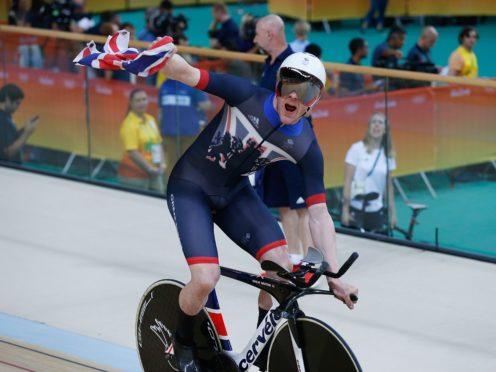 Ed Clancy celebrates winning gold (Owen Humphreys/PA)