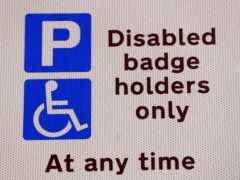 Measures are being introduced to tackle issues faced by disabled motorists applying for blue badge permits (Jonathan Brady/PA)