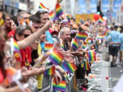 Crowds watch the Pride in London Parade along Regent Street in central London.