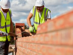 Housebuilding giant Taylor Wimpey has raised its full-year earnings outlook after swinging to a first-half profit amid Britain's booming property market.