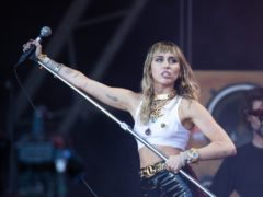 Miley Cyrus has reached out to DaBaby amid a backlash against the rapper over crude remarks he made about homosexuality and HIV (Aaron Chown/PA)