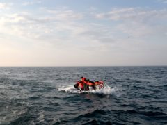 A group of people thought to be migrants crossing the Channel in a small boat (Gareth Fuller/PA)