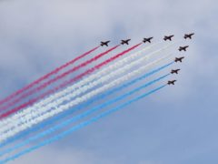 The Red Arrows show off their famous red, white and blue smoke trails (Brian Lawless/PA)