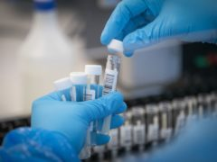 PCR Covid test providers have been warned they risk enforcement action over misleading advertising and failing to deliver results on time (Jane Barlow/PA)