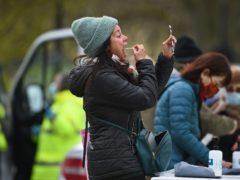 People take part in coronavirus testing (PA)