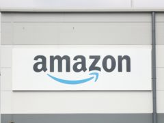 Amazon has delayed the date when office workers must return (Niall Carson/PA)