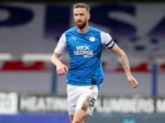 Peterborough will check on the fitness of skipper Mark Beevers (Bradley Collyer/PA)