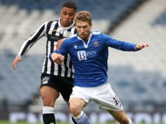 St Mirren's Ethan Erhahon (left) and St Johnstone's David Wotherspoon battle for the ball during the Scottish Cup semi-final (Andrew Milligan/PA)