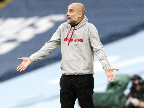 Pep Guardiola has denied saying he intends to leave Manchester City in 2023 (Martin Rickett/PA)