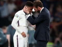 England manager Gareth Southgate consoles Jadon Sancho following defeat in the penalty shoot-out against Italy in the Euro 2020 Final at Wembley (Nick Pots/PA Images).