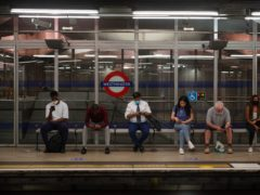 Commuters at Westminster Underground station (PA)
