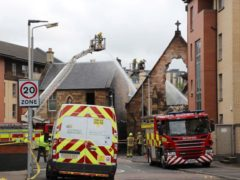 Firefighters at the scene of the fire at St Simon's Catholic Church in Glasgow (Daniel Harkins/PA)
