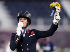Charlotte Dujardin celebrates winning bronze in the Grand Prix Freestyle to become Great Britain's most decorated female Olympian with six medals (Danny Lawson/PA)